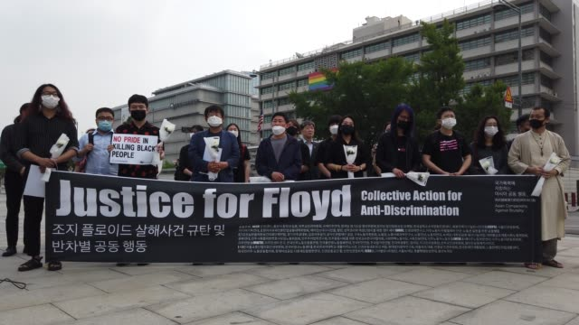 south korean activists gather to mourn the death of george floyd and show solidarity with the black lives matter movement near the u.s. embassy on... - social movement stock videos & royalty-free footage