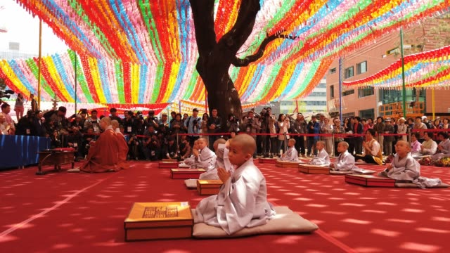 south korean child monks pray during the 'children becoming buddhist monks' ceremony forthcoming buddha's birthday at a jogye temple on april 22 2019... - buddha's birthday stock videos and b-roll footage