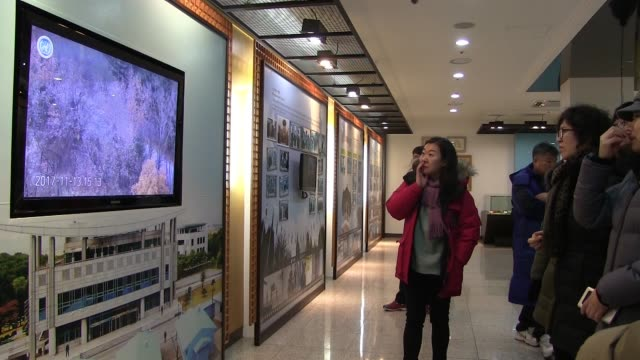 South Korean civilians visiting a small museum which presents the South Korean side of the conflict with the North located inside the visitor center...