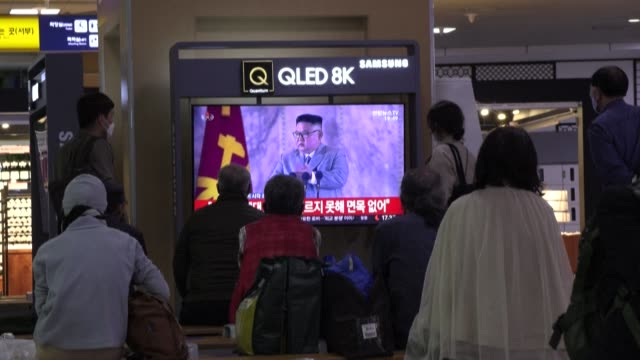 south korean commuters watch images of a north korean military parade from seoul station on saturday night broadcast, as the nuclear-armed country... - military parade stock videos & royalty-free footage
