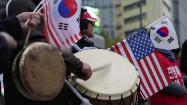 South Korean Donald Trump supporters welcoming the US President on his visit to Seoul