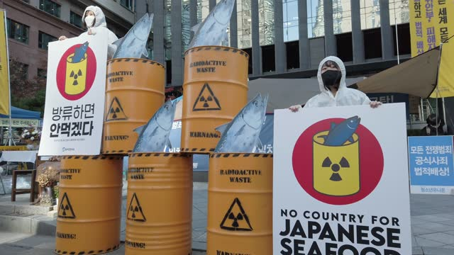 stockvideo's en b-roll-footage met south korean environmentalist with mock nuclear waste drum containers stage a rally against japan's disposal of radioactive water plan at the... - plant stage
