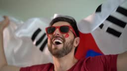 South Korean fan celebrating at home