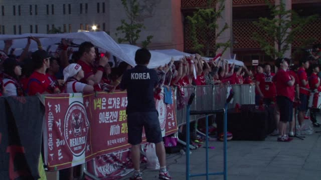 south korean fans head home dejected after the nation crashes out of the world cup following a match with belgium - international team soccer stock videos & royalty-free footage