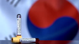 South Korean Flag Flapping Behind the Blood Test Tubes