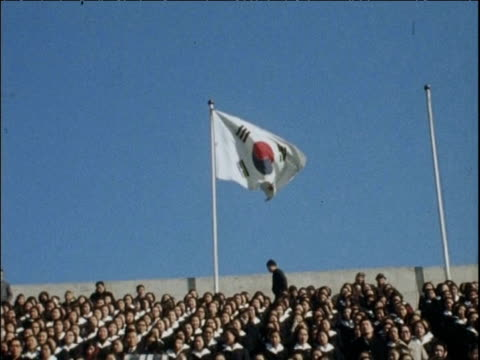 south korean flag flies over rows of protestors at south korean anti-communist demonstration seoul; 01 feb 68 - communist flag stock videos & royalty-free footage