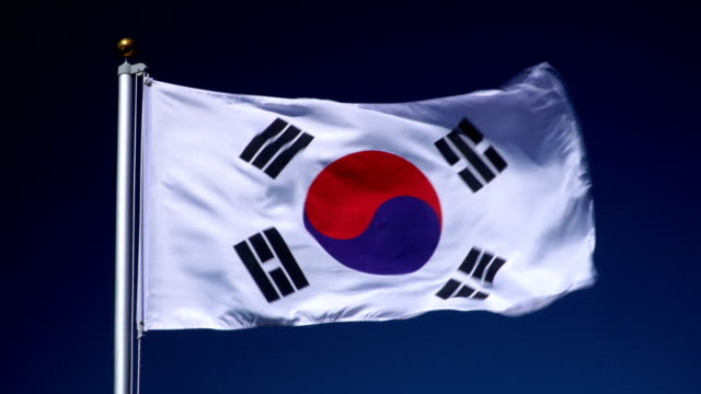 4K: South Korean Flag on Flagpole in front of Blue Sky outdoors (South Korea)