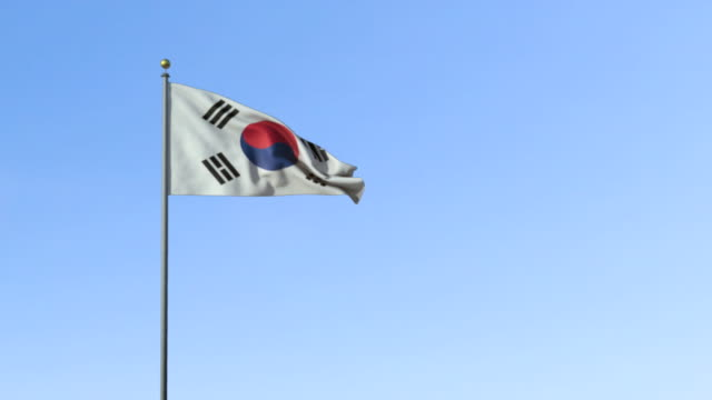 ws, south korean flag waving against blue sky - south korean flag stock videos & royalty-free footage
