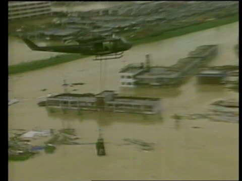 south korean floods; south korea: seoul: ext air view flooded area of city r-l air view rescued man taken in helicopter harness over flooded area... - south korea couple stock videos & royalty-free footage