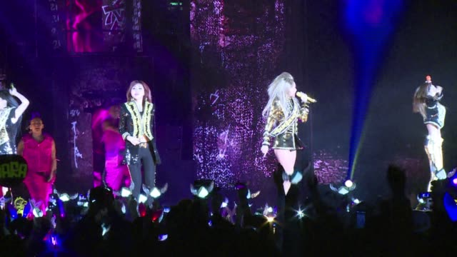 south korean girl group 2ne1 rocks the house in hong kong on the first leg of their nine city asian tour following the release of their new album... - popular music tour stock videos and b-roll footage