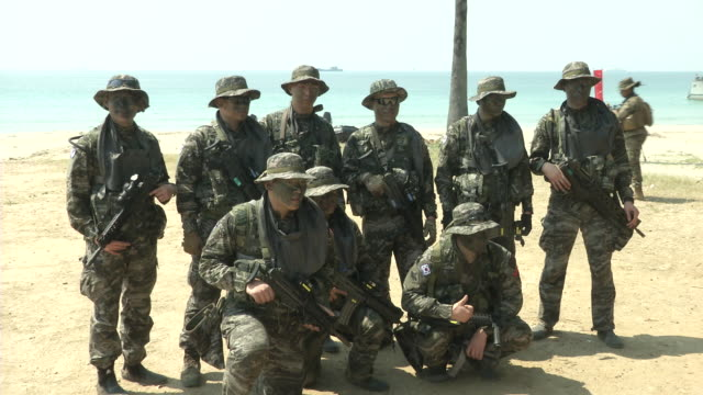 south korean military carry a boat on the beach head during the ongoing usthai joint military exercise titled cobra gold on hat yao beach in chonburi... - military exercise stock videos & royalty-free footage