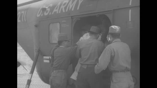 south korean pow being carried out of bus on stretcher, soldier pulling up blanket for pow, tilt up to sign over entrance tent written in korean, un... - bathrobe stock videos & royalty-free footage