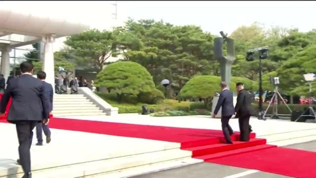 south korean president moon jae-in and north korean leader kim jong un walk during the inter-korean summit on april 27, 2018 in panmunjom, south... - roh moo hyun stock videos & royalty-free footage
