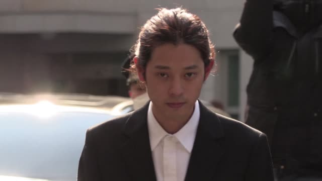 South Korean singersongwriter Jung Joon young arrives for questioning at Seoul Metropolitan Police Agency amid a burgeoning sex scandal in the Kpop...