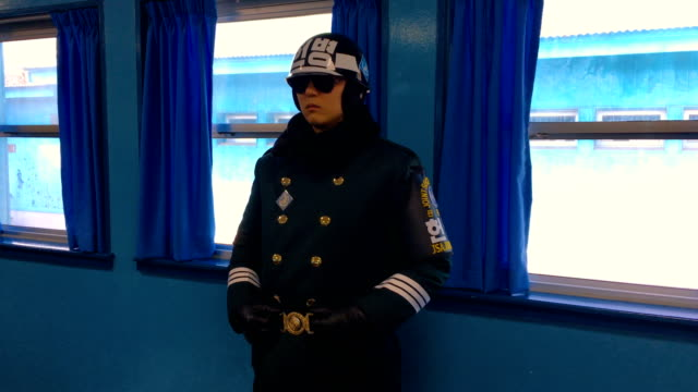 a south korean soldier stands guard inside a joint security area conference room at the border village of panmunjom in the demilitarized zone between... - court room stock-videos und b-roll-filmmaterial