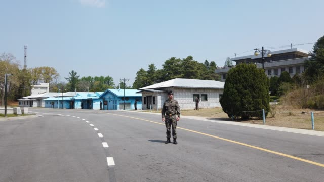south korean soldiers patrol at the truce village of panmunjom inside the demilitarized zone separating the south and north korea on may 01 2019 in... - security code stock videos and b-roll footage