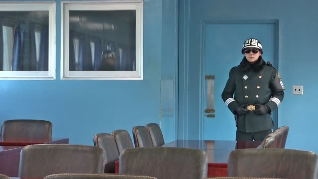 south korean soldiers stand guard in the the joint security area armistice commission conference room at the southern side of the truce village of... - armistice stock videos and b-roll footage
