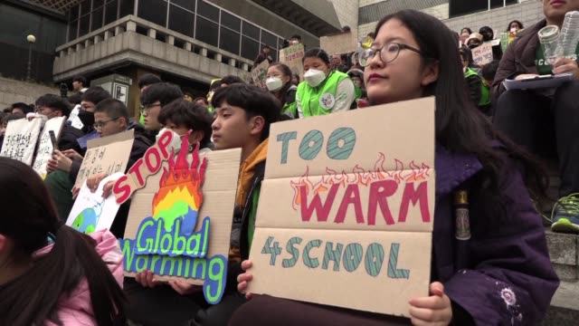 south korean students gather on the streets of seoul to protest against climate change and urge for action to be taken - asia stock videos & royalty-free footage