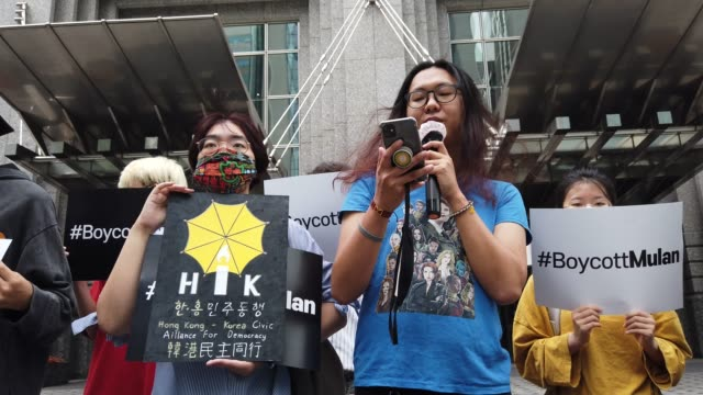 "south korean supporters of hong kong protesters participate in a rally calling for a boycott of the disney's live-action remake of ""mulan"" in front... - east asian ethnicity stock videos & royalty-free footage"