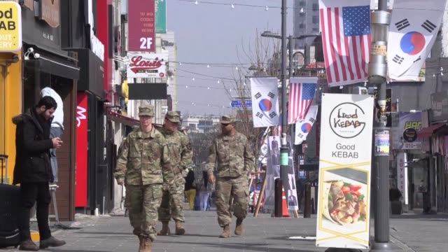 south koreans involved in the local economy surrounding us military base camp humphreys share opinions on the upcoming us dprk summit with talks... - g8:s toppmöte bildbanksvideor och videomaterial från bakom kulisserna