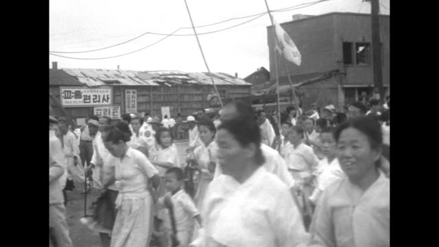 vs south koreans marching many holding banners and flags / north korean communist negotiators walking out of building in kaesong north korea / south... - korean war stock videos and b-roll footage