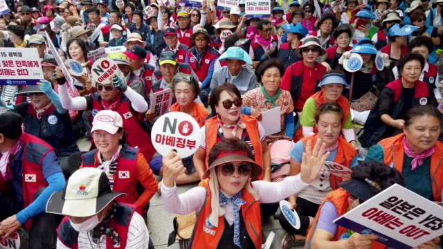 south koreans participate in a rally to denounce japan's new trade restrictions on south korea on august 13 2019 in seoul south korea the bilateral... - korea stock videos & royalty-free footage