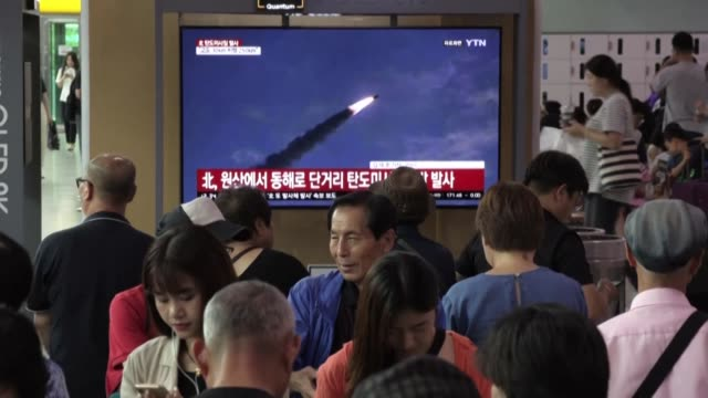 south koreans watch the news about north korea launching two short-range ballistic missiles at seoul train station days after a similar launch that... - nuclear missile launch stock videos & royalty-free footage