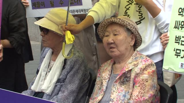 South Koreas ageing victims of Japans wartime sex slavery demonstrate and call for an apology as they prepare to file a $20 million lawsuit next...