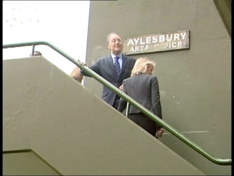 south london aylesbury housing estate michael howard mp and wife sandra howard walking up steps on estate howard pauses to look at press side ls... - grounds stock videos & royalty-free footage