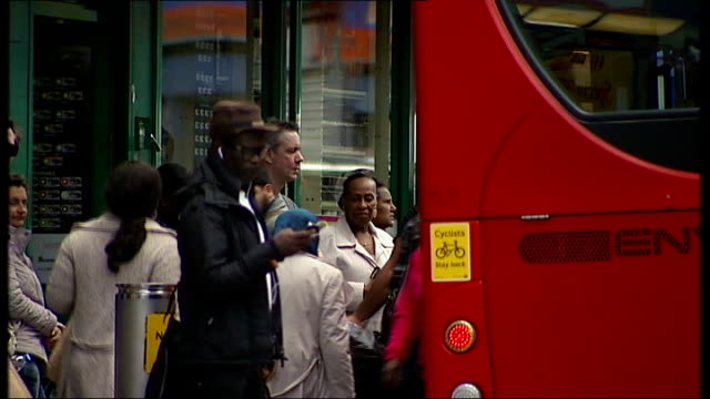 south london ext various of nigerian community along busy streets vox pops x2 gvs members of nigerian community chatting on street and along reporter... - schoolgirl stock videos & royalty-free footage