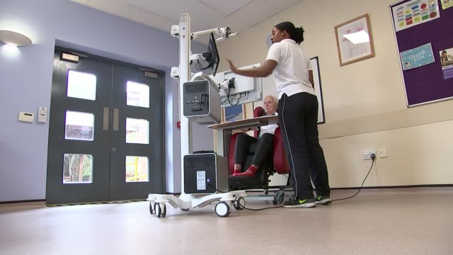 south london hospital uses virtual reality to help people recover from strokes uk london croydon university hospital karen kee interview / patient... - physiotherapy stock videos & royalty-free footage