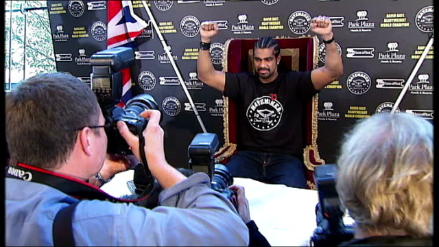 millwall: the den: ext/night reporter to camera int various shots of david haye, at press conference, posing for photocall with arms raised close... - människoarm bildbanksvideor och videomaterial från bakom kulisserna