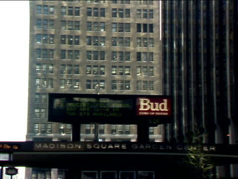 msg center electric marquee on pennsylvania station overhead on 7th avenue barely readable bud lit advertisement building bg the garden sports penn... - long island railroad stock videos & royalty-free footage