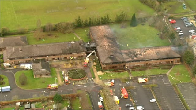 aerials air views aerials funeral home with police outside / more of south oxfordshire council offices / aerials of village / burnt out thatched... - strohdach stock-videos und b-roll-filmmaterial