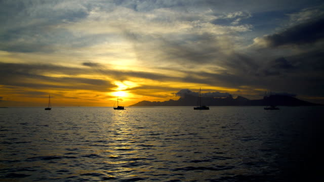 south pacific moorea island from tahiti at sunset - south pacific ocean stock-videos und b-roll-filmmaterial
