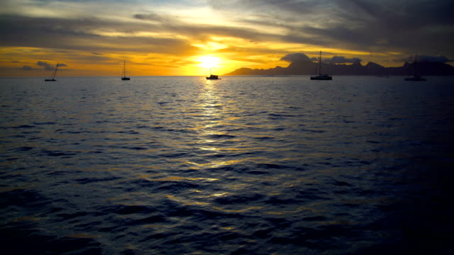 south pacific moorea island from tahiti at sunset - polynesian ethnicity stock videos & royalty-free footage