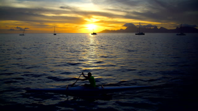 south pacific moorea island from tahiti at sunset - moorea stock videos & royalty-free footage
