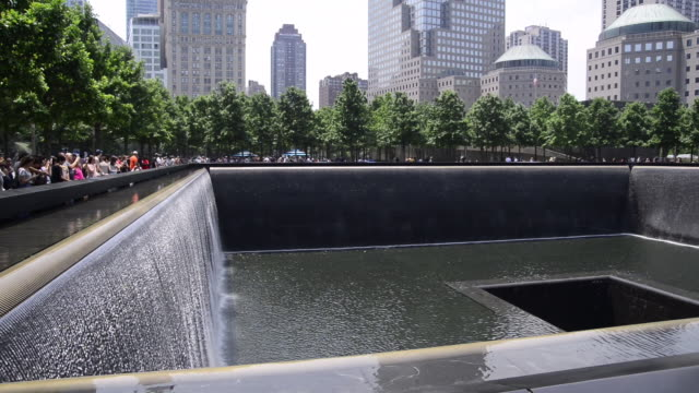 south pool waterfall at the world trade centre memorial in manhattan, new york, also know as the 9/11 memorial - world trade center manhattan video stock e b–roll