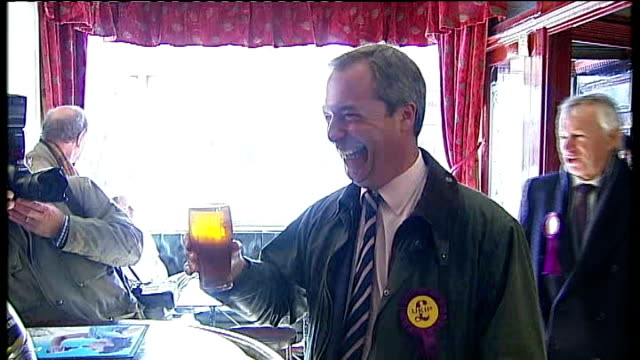 campaigning england tyne and wear south shields photography** variuos of nigel farage mep standing at bar in pub drinking pint of beer holds up pint... - pint glass stock videos & royalty-free footage