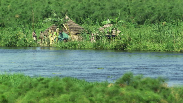south sudan :  homes near the nil - village stock videos & royalty-free footage