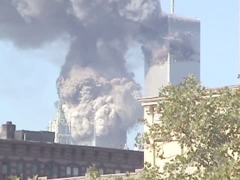south tower of the world trade center collapses. footage taken from a rooftop in the lower east side, new york city, profanity used in audio... - tower stock videos & royalty-free footage