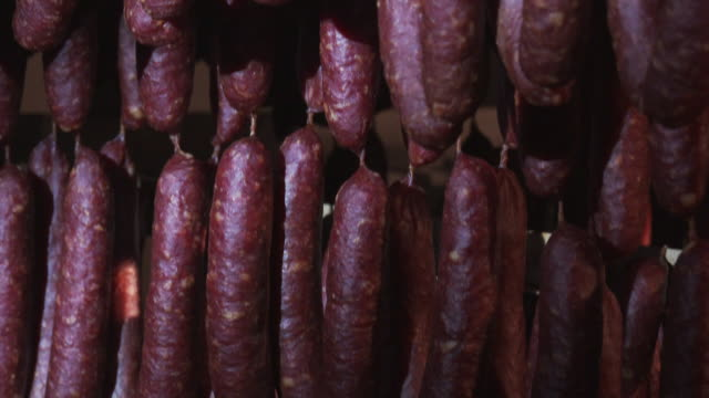 south tyrolean specialty, smoked sausages - sausage stock videos & royalty-free footage