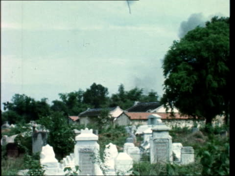 South Vietnamese planes drop napalm on South Vietnamese civilians VIETNAM SOUTH TRANG G/A Skyraider LR tilt to explosions in town in LV G/A Small...