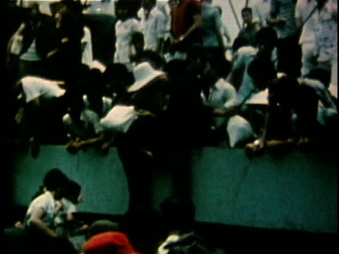 south vietnamese refugees climbing aboard crowded passenger ship after the fall of saigon / saigon south vietnam - south vietnam stock videos and b-roll footage