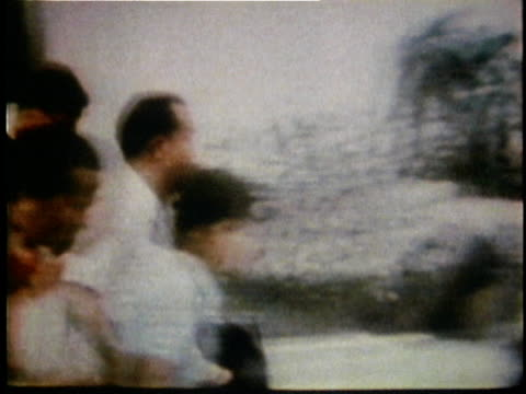 south vietnamese refugees running in a panic toward waiting us military helicopter after the fall of saigon / saigon south vietnam - 1975 stock videos & royalty-free footage