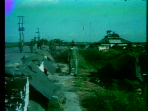 south vietnamese soldiers and refugees crowd along a highway in saigon at the end of the vietnam war in 1972. - south vietnam stock videos & royalty-free footage