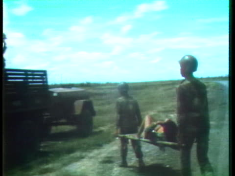 south vietnamese soldiers carry a casualty on a stretcher to a waiting truck during the vietnam war. - south vietnam stock videos & royalty-free footage