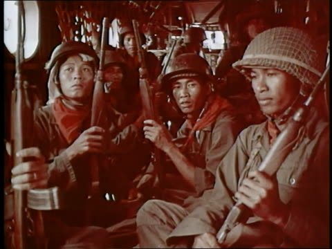 south vietnamese soldiers hold their rifles while they sit in a helicopter. - vietnam war stock videos & royalty-free footage