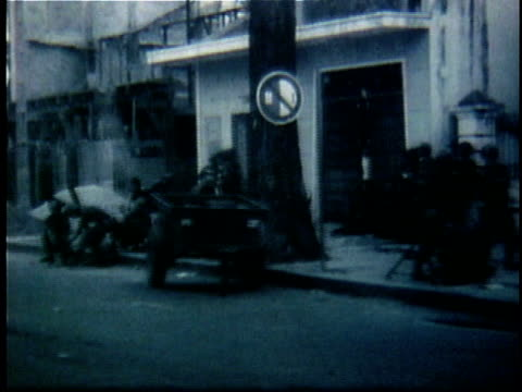 south vietnamese soldiers on city streets at the time of diem's assassination / south vietnam - anno 1963 video stock e b–roll