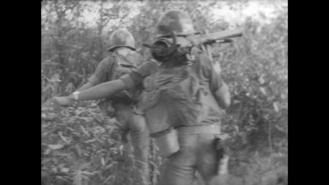 south vietnamese troops pour into mekong delta to find viet cong operatives in the rice paddies and jungle area / soldiers struggle across terrain... - south vietnam stock videos & royalty-free footage